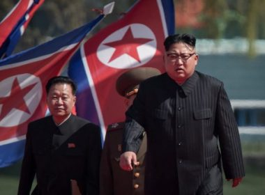 """(FILES) In a file photo taken on April 13, 2017 North Korean leader Kim Jong-Un (R) arrives flanked by vice-chairman of the State Affairs Commission Choe Yong-Hae (L) at an opening ceremony for 'Rymoyong street', a new housing development in Pyongyang. North Korea threatened on June 28, 2017 to """"impose the death penalty"""" on the South's former president Park Geun-Hye over an alleged plot to assassinate its leader Kim Jong-Un. / AFP PHOTO / ED JONES / XGTY"""