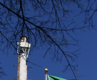 WASHINGTON, DC - JANUARY 04: The flag of the Kingdom of Saudi Arabia flys next to a pole-mounted security camera at its embassy in the United States January 4, 2016 in Washington, DC. Saudia Arabia severed diplomatic ties with Iran after protesters ransacked and set fire to its embassy in Tehran on Saturday, along with the Saudi Consulate in IranÕs second-largest city, Mashhad, after the Saudis executed a Shiite cleric, Sheikh Nimr al-Nimr.   Chip Somodevilla/Getty Images/AFP