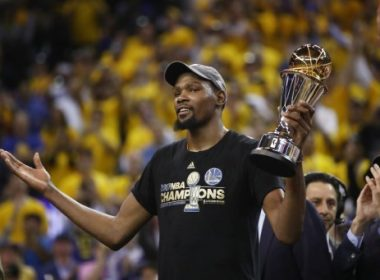 OAKLAND, CA - JUNE 12: Kevin Durant #35 of the Golden State Warriors celebrates after being named Bill Russell NBA Finals Most Valuable Player after defeating the Cleveland Cavaliers 129-120 in Game 5 to win the 2017 NBA Finals at ORACLE Arena on June 12, 2017 in Oakland, California. NOTE TO USER: User expressly acknowledges and agrees that, by downloading and or using this photograph, User is consenting to the terms and conditions of the Getty Images License Agreement.   Ezra Shaw/Getty Images/AFP