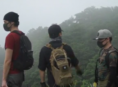 Atop Hong Kong's tallest peak blanketed in clouds, three masked urban explorers took a step back in time as they climbed through a hole in a wire mesh fence, climbed down a hill and marched towards an abandoned army barracks built during British colonial times, likely used during World War Two. Photo grabbed from Reuters video file.