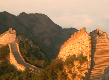 As the sun rises over one of the most dangerous and least-restored stretches of China's Great Wall, a line of pack mules emerge from the gloom of a dense forest still draped in mist and dew. Photo grabbed from Reuters video file.