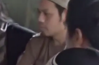 Alleged Malaysian militant financier Mahmud bin Ahmad in a video where Abu Sayyaf leader Isnilon Hapilon and Abdullah Maute were seen planning the Marawi attack.  (Photo grabbed from June 7 Reuters-provided video)