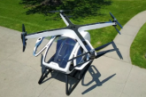 """The SureFly two-seater octocopter is unveiled at the Paris Air Show ahead of test flights later this year. It's described by US makers Workhorse as """"basically a massive drone"""" and an easy-to-operate personal flying machine.(photo grabbed from Reuters video)"""