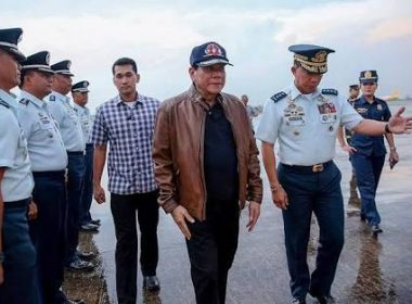 In this photo released by Malacañang, President Rodrigo Duterte is seen walking along a coastline. The Palace said this was taken at Villamor Airbase in Pasay on Thursday, June 15.