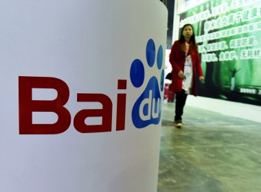 File Photo: This photo shows a woman walking past the Baidu booth at the China (ShangHai) International Technology Fair in Shanghai. / AFP PHOTO/