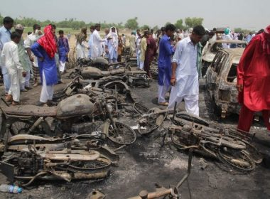 (FILES) This file photo taken on June 26, 2017 shows Pakistani villagers gathering at the site of a deadly oil tanker fire following an accident in the town of Ahmedpur East. The death toll from a deadly oil tanker explosion in central Pakistan has risen to 174, officials said June 29, as a high level inquiry into the blitz remained inconclusive.  / AFP PHOTO / SS MIRZA