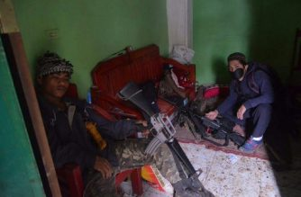 This undated handout photo received from the Philippine military on July 10, 2017 shows militant members of the so-called Maute group, an ISIS-affiliated group, inside a house in Marawi. Militants seized Marawi, considered the Muslim capital of the largely Catholic Philippines, on May 23 in a bid to create an IS province, and over 100 remain holed up in the city despite intense military efforts to oust them. / AFP PHOTO / PHILIPPINE MILITARY / Handout