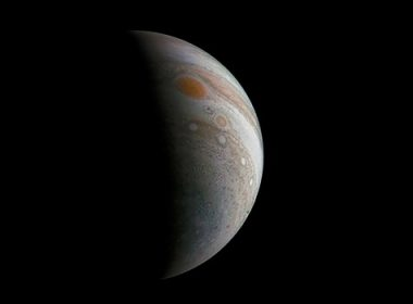 (FILES) This file photo shows a NASA image obtained January 17, 2017, of a crescent Jupiter and the Great Red Spot created by a citizen scientist (Roman Tkachenko) using data from Juno's JunoCam instrument, taken on December 11, 2016 at 2:30 p.m. PST (5:30 p.m. EST), as the Juno spacecraft performed its third close flyby of Jupiter.  Juno is about to fly over the Great Red Spot in a long-awaited journey that could shed new light on the forces driving the planet's giant storm. The flyby of the Juno spacecraft, surveilling the 10,000-mile-wide (16,000-kilometer-wide) storm, is scheduled for 9:55 pm on July 10, 2017, (0155 GMT Tuesday).  / AFP PHOTO / NASA / Handout / RESTRICTED TO EDITORIAL USE - MANDATORY CREDIT AFP PHOTO /NASA/JPL-Caltech/SwRI/MSSS/Roman Tkachenko  - NO MARKETING - NO ADVERTISING CAMPAIGNS - DISTRIBUTED AS A SERVICE TO CLIENTS