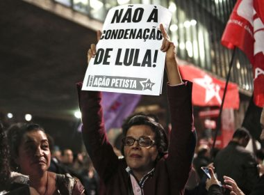 """A woman holds a sign reading """"No to Lula's sentence"""" in Sao Paulo, Brazil, July 12, 2017, after Brazil's former president Luiz Inacio Lula da Silva was sentenced to nearly 10 years in prison for graft. Lula, who ruled Brazil from 2003-2010, was convicted and handed a 9.5-year prison term for accepting a bribe of a luxury seaside apartment and $1.1 million. But anti-corruption judge Sergio Moro, who handed down the sentence, said the 71-year-old Lula would remain free pending an appeal -- something his lawyers immediately said they would lodge. / AFP PHOTO / Miguel SCHINCARIOL"""