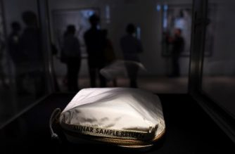The Apollo 11 Contingency Lunar Sample Return Bag, used by Neil Armstrong on Apollo 11 to bring back the very first pieces of the moon ever collected, is displayed during a media preview for Space Exploration auction in New York on July 13, 2017.  / AFP PHOTO / Jewel SAMAD