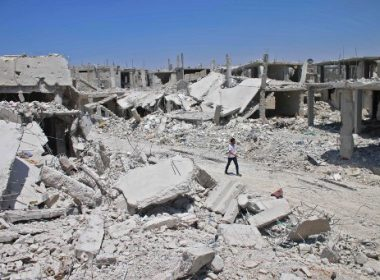 A Syrian man walks down a destroyed street in a rebel-held area in Daraa on July 19, 2017, as civilians started to return to the area following the July 9 agreement ceasefire brokered by the United States, Russia and Jordan creating a de-escalation zone in Syria's southern Daraa, Quneitra and Sweida regions.  / AFP PHOTO / Mohamad ABAZEED