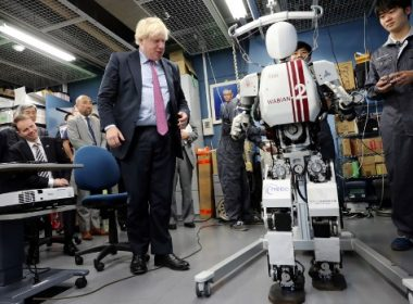 Britain's Foreign Secretary Boris Johnson looks at a humanoid robot Wabian2 at the Research Institute for Science and Engineering at Waseda University's Kikuicho Campus in Tokyo on July 20, 2017.   / AFP PHOTO / POOL / Eugene Hoshiko