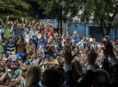 "People cheer as the judges named by Venezuela's opposition-controlled National Assembly for a parallel supreme court, swear in during a ceremony in Caracas on July 21, 2017. Venezuela's supreme court, which has systematically sided with President Nicolas Maduro to sideline the parliament, rejected a declaration by the legislature to name 33 judges for a parallel supreme court. The tribunal warned that opposition lawmakers risked charges of ""usurption"" for making that bid. The death toll in anti-government protests in the country since April has reached 100, prosecutors said Friday. / AFP PHOTO / Juan BARRETO"
