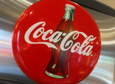 (FILES) This file photo taken on May 1, 2016 shows a Coca-Cola logo  seen in a restaurant in Washington, DC. Coca-Cola saw profits drop sharply due to sales of bottling facilities as it moved to expand offerings of low-sugar and non-carbonated beverages amid flagging demand for sweet sodas, the company said on July 26, 2017. Net income for the US soft drinks giant plunged 60 percent in the second quarter to $1.4 billion, while revenues fell 16 percent to $9.7 billion. Both were hit by the company's move to offload bottling assets in North America.  / AFP PHOTO / Karen BLEIER
