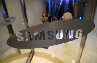 (FILES) This file photo taken on July 7, 2017 shows a woman walking past the logo of Samsung at the company's showroom in Seoul. /AFP Photo / Jung Yeon-Je