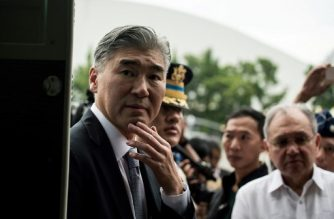 US Ambassador to the Philippines Sung Kim looks inside a Cessna-208B Grand Caravan Intelligence, Surveillance and Recoinnaissance (ISR) aircraft acquired through grant programmes by the the US government to the Philippine Air Force (PAF) during a formal turn-over ceremony at the PAF headquarters in Manila on July 27, 2017. Two Cessna-208B Grand Caravan Intelligence, Surveillance and Recoinnaissance (ISR) aircraft were acquired through the grant programmes. / AFP PHOTO / Noel CELIS