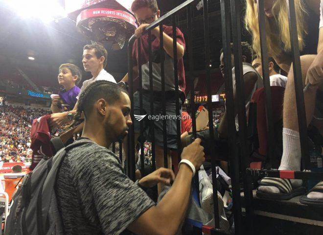 Featured Photo: Gian Clavell of the Miami Heat signing autographs for young fans at the NBA Summer League in Las Vegas, NV