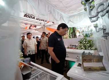 President Rodrigo Roa Duterte looks at the remains of the victims to commiserate with the Carlos family during a wake visit at San Jose del Monte City in Bulacan on July 4, 2017. Five of the Carlos family: Estrella, 30-yrs old; Auring Dizon, 53-yrs old; Donnie, 11-yrs old; Ella, 7-yrs old; and Dexter, 1-yr old massacred in their house on June 27, 2017. After the President extended his condolences, he handed the government's financial assistance to the bereaved family. KING RODRIGUEZ/PRESIDENTIAL PHOTO