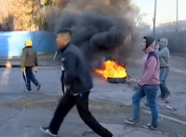 Friends, family and neighbours of a 19-year-old pregnant suspected murder victim lit several cars on fire and threw rocks at police outside a police station in the city of Glew south of Buenos Aires on Wednesday (July 5). Photo grabbed from Reuters video file.
