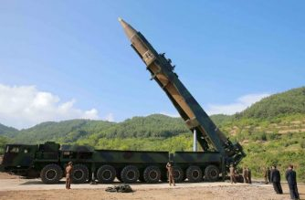"""This picture taken and released on July 4, 2017 by North Korea's official Korean Central News Agency (KCNA) shows North Korean leader Kim Jong-Un (2nd R) inspecting the test-fire of the intercontinental ballistic missile Hwasong-14 at an undisclosed location. North Korea declared on July 4 it had successfully tested its first intercontinental ballistic missile -- a watershed moment in its push to develop a nuclear weapon capable of hitting the mainland United States. / AFP PHOTO / KCNA VIA KNS / STR / South Korea OUT / REPUBLIC OF KOREA OUT   ---EDITORS NOTE--- RESTRICTED TO EDITORIAL USE - MANDATORY CREDIT """"AFP PHOTO/KCNA VIA KNS"""" - NO MARKETING NO ADVERTISING CAMPAIGNS - DISTRIBUTED AS A SERVICE TO CLIENTS THIS PICTURE WAS MADE AVAILABLE BY A THIRD PARTY. AFP CAN NOT INDEPENDENTLY VERIFY THE AUTHENTICITY, LOCATION, DATE AND CONTENT OF THIS IMAGE. THIS PHOTO IS DISTRIBUTED EXACTLY AS RECEIVED BY AFP.   /"""