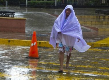 FILE PHOTO: A woman along a street under the rain caused by the passage of tropical storm Franklin in Merida, Yucatan, Mexico on August 8, 2017. Tropical Storm Franklin swept Mexico's Yucatan Peninsula on Tuesday, dumping heavy rain on its pristine beaches but doing relatively little damage -- though the country was braced for a second round. Franklin made landfall early Tuesday some 350 kilometers (215 miles) south of the beach resort of Cancun, and was advancing to the northwest at 20 kilometers per hour, according to the US National Hurricane Center (NHC). / AFP PHOTO / HUGO BORGES