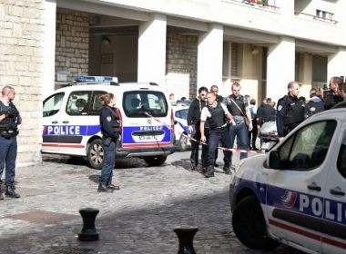 Police gather at the site where a car slammed into soldiers on patrol in Levallois-Perret, outside Paris, on August 9, 2017. A car slammed into soldiers on patrol outside Paris on on August 9, injuring six people, two of them seriously, police said. The vehicle took off after the incident, which took place at about 8:00 am (0600 GMT) in the northwestern suburb of Levallois-Perret.  / AFP PHOTO / STEPHANE DE SAKUTIN