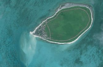 "This handout photo taken on December 14, 2012 by satellite imagery provider DigitalGlobe and released to AFP on August 11, 2017 by the Asia Maritime Transparency Initiative (AMTI) department at the Center for Strategic and International Studies (CSIS) think tank shows an overview satellite image of Tree Island in the disputed Paracels island chain in the South China Sea. China is expanding artificial islands in disputed South China Sea areas despite saying it stopped two years ago, according to a security think tank that released satellite images it said showed the land reclamation. Beijing claims most of the sea and has been turning reefs in the Spratly and Paracel chains into islands, installing military aircraft and missile systems on them -- an activity the Asia Maritime Transparency Initiative (AMTI) said was continuing. / AFP PHOTO / CSIS / DigitalGlobe / -----EDITORS NOTE --- RESTRICTED TO EDITORIAL USE - MANDATORY CREDIT ""AFP PHOTO / CSIS Asia Maritime Transparency Initiative / DigitalGlobe"" - NO MARKETING NO ADVERTISING CAMPAIGNS - DISTRIBUTED AS A SERVICE TO CLIENTS - NO ARCHIVES NOTE: STRICTLY FOR USE WITH AFP STORY ON IMAGE /"