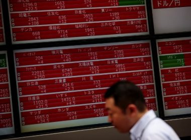A man walks past a stock quotation board of the Tokyo Stock Exchange in Tokyo on August 15, 2017. Tokyo shares rebounded in the morning on August 15 after four days of losses as fears over a US-North Korea military conflict began to recede. / AFP PHOTO / Behrouz MEHRI