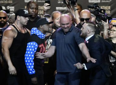 File Photo: This photo  shows Floyd Mayweather Jr. (L)as he faces off for the first time with UFC fighter Conor McGregor during a press call at the Staples Center in  Los Angeles, California. / AFP PHOTO /