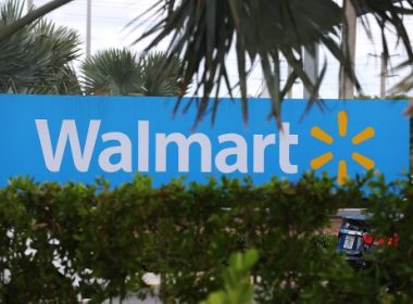 (FILES) This file photo taken on August 17, 2015 shows a Walmart sign in Miami, Florida.  Discount retail giant Walmart updated investors on August 17, 2017 on its latest gadgets and time-saving options aimed at luring shoppers away from arch-rival Amazon, but the efforts come at a cost. The good news? The company's array of investments in e-commerce, store beautification, low prices and higher employee pay are indeed driving higher store traffic and sales.The bad news? Profits fell sharply due to the increased cost of those efforts.  / AFP PHOTO / GETTY IMAGES NORTH AMERICA / JOE RAEDLE