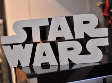 """(FILES) This file photo taken on November 24, 2015 shows a Star Wars logo sign atop a popcorn machine inside Rancho Obi-Wan, the world's largest private collection of Star Wars memorabilia, in Petaluma, California. Oscar-nominated filmmaker Stephen Daldry is in early talks to direct a """"Star Wars"""" spin-off about Jedi master Obi Wan Kenobi, US media reported on Thursday. There is no script yet and no actor attached to play the bearded warrior and sage made famous by Alec Guinness, who died 17 years ago, in the original series of films.   / AFP PHOTO / Josh Edelson"""