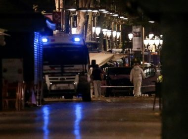 "The van which ploughed into the crowd, killing at least 13 people and injuring around 100 others is seen momnets before being towed away from the Rambla in Barcelona on August 18, 2017. A driver deliberately rammed a van into a crowd on Barcelona's most popular street on August 17, 2017 killing at least 13 people before fleeing to a nearby bar, police said.  Officers in Spain's second-largest city said the ramming on Las Ramblas was a ""terrorist attack"". The driver of a van that mowed into a packed street in Barcelona is still on the run, Spanish police said. / AFP PHOTO / PAU BARRENA"