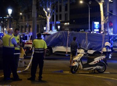 """The van who ploughed into the crowd, killing at least 13 people and injuring around 100 others is towed away from the Rambla in Barcelona on August 18, 2017. A driver deliberately rammed a van into a crowd on Barcelona's most popular street on August 17, 2017 killing at least 13 people before fleeing to a nearby bar, police said.  Officers in Spain's second-largest city said the ramming on Las Ramblas was a """"terrorist attack"""". The driver of a van that mowed into a packed street in Barcelona is still on the run, Spanish police said. / AFP PHOTO / Josep LAGO"""