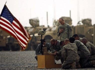 (FILES) In this photograph taken on September 14, 2010, US army officers with the 101st Airborne Division pay their respects by the boots, gun, helmet and dog-tags of US army First Lieutenant Todd W. Weaver displayed during a memorial ceremony in his honor at Combat Outpost Terra Nova on the outskirts the Arghandab Valley's Jellawar village. US President Donald Trump will announce his decision on America's strategy in Afghanistan in an address to US troops and the nation, almost 16 years after the war began on August 21, 2017. / AFP PHOTO / PATRICK BAZ