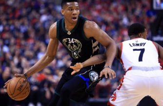 TORONTO, ON - APRIL 15: Giannis Antetokounmpo #34 of the Milwaukee Bucks dribbles the ball as Kyle Lowry #7 of the Toronto Raptors defends in the first half of Game One of the Eastern Conference Quarterfinals during the 2017 NBA Playoffs at Air Canada Centre on April 15, 2017 in Toronto, Canada. NOTE TO USER: User expressly acknowledges and agrees that, by downloading and or using this photograph, User is consenting to the terms and conditions of the Getty Images License Agreement.   Vaughn Ridley/Getty Images/AFP