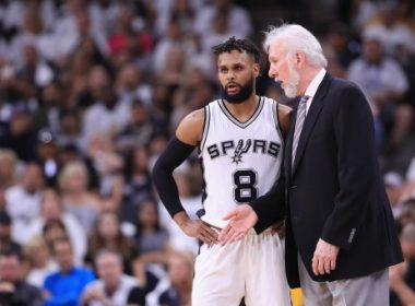 SAN ANTONIO, TX - MAY 20: Head coach Gregg Popovich of the San Antonio Spurs talks with Patty Mills #8 in the first half against the Golden State Warriors during Game Three of the 2017 NBA Western Conference Finals at AT&T Center on May 20, 2017 in San Antonio, Texas. NOTE TO USER: User expressly acknowledges and agrees that, by downloading and or using this photograph, User is consenting to the terms and conditions of the Getty Images License Agreement.   Ronald Martinez/Getty Images/AFP