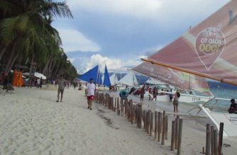 "DOT, DILG, DENR to recommend ""total closure"" of Boracay to pave way for island cleanup"