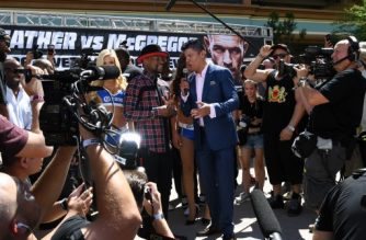 LAS VEGAS, NV - AUGUST 22: Floyd Mayweather Jr. (center L) is interviewed as he arrives at Toshiba Plaza on August 22, 2017 in Las Vegas, Nevada. Mayweather will fight UFC lightweight champion Conor McGregor in a super welterweight boxing match at T-Mobile Arena on August 26 in Las Vegas.   Ethan Miller/Getty Images/AFP