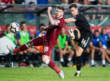 Liverpool's Alberto Moreno (L) and Leicester City's Tom Lawrence (R) compete for the ball during the final of the Premier League Asia Trophy football tournament between Liverpool and Leicester City in Hong Kong on July 22, 2017. / AFP PHOTO / DALE DE LA REY / RESTRICTED TO EDITORIAL USE. No use with unauthorised audio, video, data, fixture lists, club/league logos or 'live' services. Online in-match use limited to 75 images, no video emulation. No use in betting, games or single club/league/player publications.