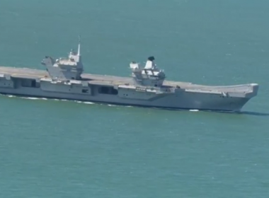 Britain's most advanced and biggest warship, 65,000-tonne aircraft carrier HMS Queen Elizabeth, continued its sea trials on Tuesday (August 15) off the Isle of Wight in England.(photo grabbed from Reuters video)