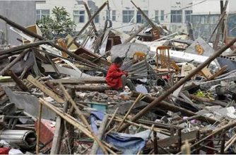A survivor among the debris after an earthquake struck China in 2008. Credit Liu Jin/Agence-France Presse/ Getty Images