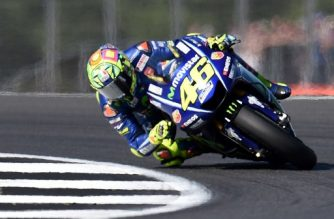 Movistar Yamaha MotoGP's Italian rider Valentino Rossi leads during the MotoGP race of the British Grand Prix at Silverstone circuit in Northamptonshire, southern England, on August 27, 2017. / AFP PHOTO / Oli SCARFF