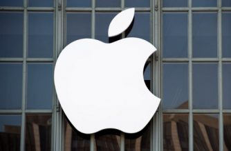 """(FILES) This file photo taken on September 7, 2016 shows the Apple logo on the outside of Bill Graham Civic Auditorium in San Francisco, California. Apple sent out invitations on August 31, 2017 to a first-ever media event in the Steve Jobs Theater at its new """"spaceship"""" campus in Silicon Valley. The keenly anticipated event set for September 12 is expected to star iPhone models marking the tenth anniversary of the culture-changing smartphones. In trademark style, Apple revealed little in the invitation that provided the date, time, location and a message that read """"Let's meet at our place.""""  / AFP PHOTO / Josh Edelson"""