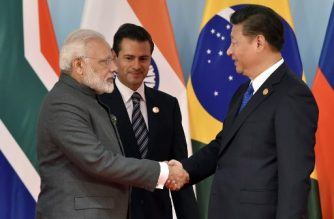 Chinese President Xi Jinping (R) and Indian Prime Minister Narendra Modi (L) shake hands before the group photo session at the Dialogue of Emerging Market and Developing Countries on the sidelines of the 2017 BRICS Summit in Xiamen, southeastern China's Fujian Province on September 5, 2017. Xi opened the annual summit of BRICS leaders that already has been upstaged by North Korea's latest nuclear weapons provocation. / AFP PHOTO / POOL / Kenzaburo FUKUHARA