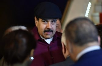 Venezuelan President Nicolas Maduro arrives at the Houari Boumedien Airport in Algiers for a two-day visit on September 10, 2017. Maduro is visiting fellow oil exporter Algeria days after announcing his country would sell crude in non-dollar currencies in a bid to resist US sanctions. / AFP PHOTO / RYAD KRAMDI / RYAD KRAMDI
