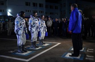 Members of the International Space Station (ISS) expedition 53/54, US astronauts Joseph Akaba (L) and Mark Vande Hei (C) and Russia's cosmonaut Alexander Misurkin (3rdL) attend a sending-off ceremony in the Russian-leased Baikonur cosmodrome in Kazakhstan early on September 13, 2017. The launch of the Soyuz MS-06 with the members of the International Space Station (ISS) expedition 53/54, US astronauts Joseph Akaba and Mark Vande Hei and Russia's cosmonaut Alexander Misurkin is scheduled for early September 13 local time from the Russian-leased Kazakh Baikonur cosmodrome. / AFP PHOTO / Kirill KUDRYAVTSEV