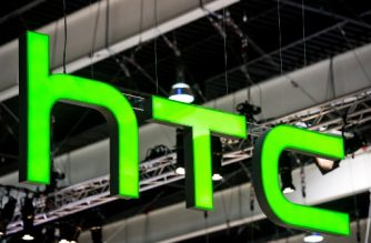 (FILES) This file photo taken on March 01, 2017 shows a HTC logo hanging from a beam during the Mobile World Congress on the third day of the MWC in Barcelona. Taiwan's struggling smartphone maker HTC said on September 21, 2017, it was selling part of its smartphone business to US technology giant Google for 1.1 billion USD. / AFP PHOTO / Josep LAGO