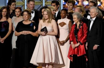LOS ANGELES, CA - SEPTEMBER 17: Actress Elisabeth Moss (L) and author Margaret Atwood with cast and crew of 'The Handmaid's Tale' accept the Outstanding Drama Series award onstage during the 69th Annual Primetime Emmy Awards at Microsoft Theater on September 17, 2017 in Los Angeles, California.   Kevin Winter/Getty Images/AFP