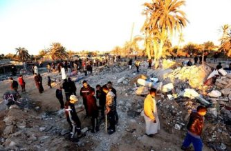 Libyans gather next to debris at the site of a jihadist training camp, targeted in a US air strike, near the Libyan city of Sabratha on February 19, 2016 (AFP Photo/Mahmud Turkia)