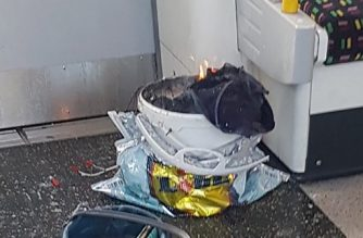 A handout picture obtained from the twitter user @sylvainpennec shows a white container burning inside a London Underground tube carriage at Parsons Green underground tube station on September 15, 2017.  / AFP PHOTO / @sylvainpennec